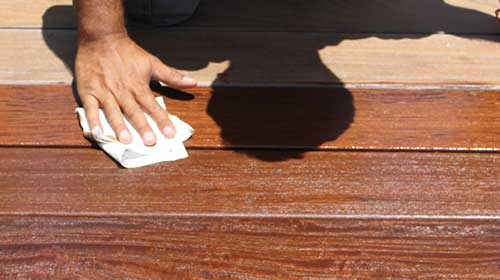 Wipe excess oil from your deck