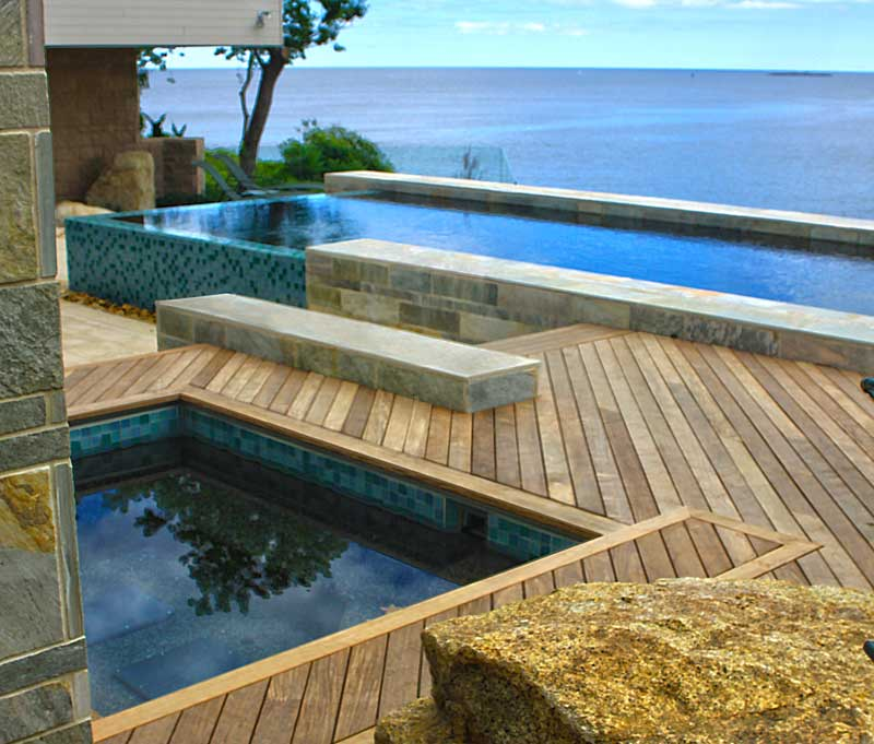 Beautiful exotic hardwood pool deck built with Ipe Clip® hidden deck fasteners