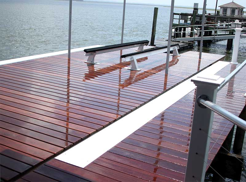 Freshly oiled dock constructed with hidden edge mount fastener clips by Ipe Clip®